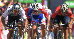 Peter Sagan (left)  wins the sprint  ahead of Italy's Sonny Colbrelli (right) and France's Arnaud Demare (centre) in the  second stage  of the Tour de France  between Mouilleron-Saint-Germain and La Roche-sur-Yon. Photograph:  Marco Bertorello/AFP/Getty Images
