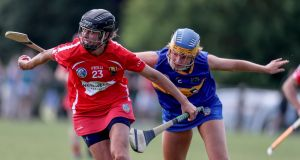 Cork's Orla Cotter and Caroline Mullaney of Tipperary in action during the championship clash at The Ragg. Photograph: Dan Sheridan/Inpho