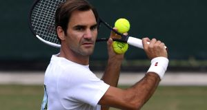 Roger Federer during practice ahead of his match with   22nd seed Adrian Mannarino. Photograph: Tony O'Brien/Reuters