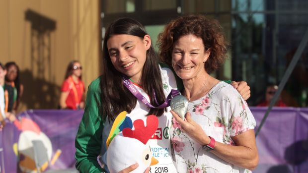 Ireland's Sophie O'Sullivan is presented with her silver medal from the 800m by her mother Sonia at the European Under-18 Championships in Gyor, Hungary. Photograph: Sasa Pahic Szabo/Inpho