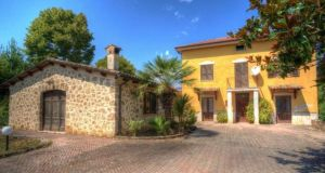 This period farmhouse is surrounded by fields in Lazio, south of Rome in Italy.