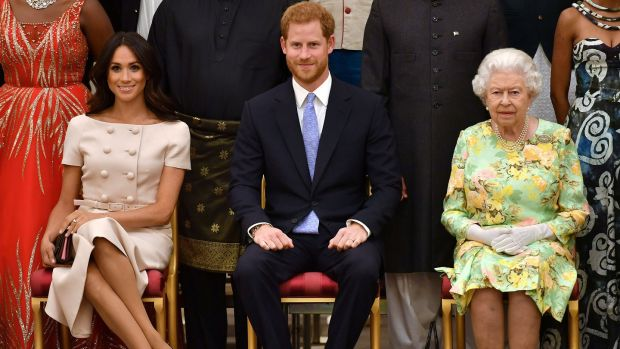 Queen Elizabeth, Prince Harry and Meghan at the Queen's Young Leaders Awards Ceremony, in London, June 26th, 2018. Photograph: John Stillwell/Pool via Reuters