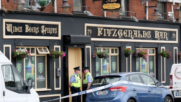 Gardaí at Fitzgerald's Bar on Sexton Street North, in Limerick city where Patrick O'Connor was fatally stabbed. Photograph: Don Moloney/Press 22