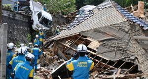Rescuers prepare to  search  for missing person at the site of a landslide in Kumano town, Hiroshima prefecture, on Monday. Photograph: AP