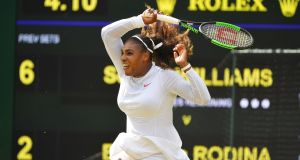 Serena Williams  in action during the fourth-round match against Russia's Evgeniya Rodina at Wimbledon. Photograph: Toby Melville/Reuters