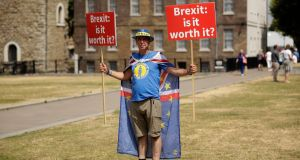 Anti-Brexit, pro-EU supporter Steve Bray holds placards on Abingdon Green across the road from the Houses of Parliament in London on Monday. Photograph: Matt Dunham/AP