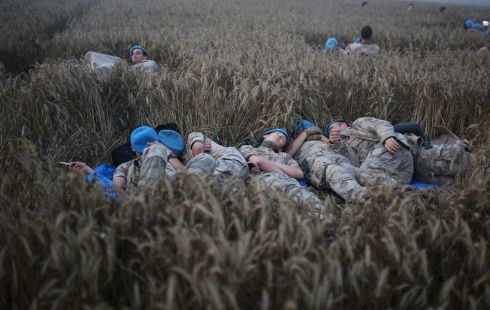 FLAT OUT: Turkish soldiers rest after carrying out rescue work at the site of a fatal train derailment in Tekirdag, Turkey. According to the Turkish Health Ministry, 10 people died and 72 were wounded in the incident. Photograph: EPA