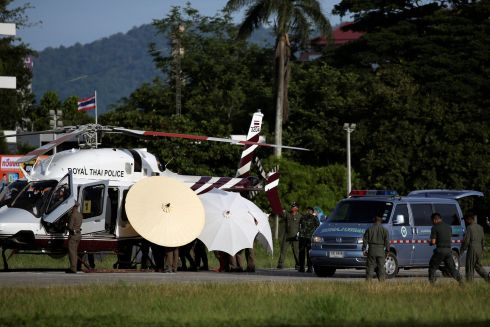ORDEAL OVER: Rescued schoolboys are moved from a Royal Thai Police helicopter to a waiting ambulance at a military airport in Chiang Rai, Thailand, after they spent more than two weeks trapped in a cave. Photograph: Athit Perawongmetha/Reuters