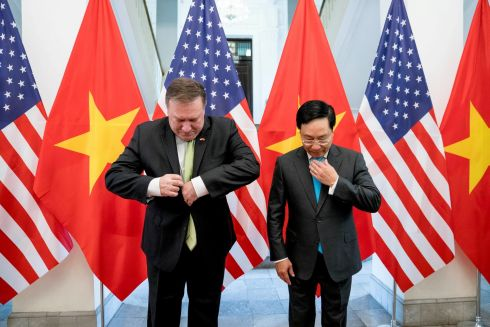 ALL TIED UP: US secretary of state Mike Pompeo and Vietnamese deputy prime minister and foreign minister Pham Binh Minh arrive for a photo opportunity before a meeting at the Ministry of Foreign Affairs in Hanoi, Vietnam. Andrew Harnik/Pool via Reuters
