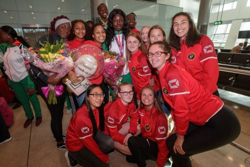 FLUSHED WITH SUCCESS: Rhasidat Adeleke (centre, with medal) with friends from Tallaght AC at the Team Ireland homecoming at Dublin Airport after the European Athletics Under-18 Championships. Photograph: Gary Carr/Inpho