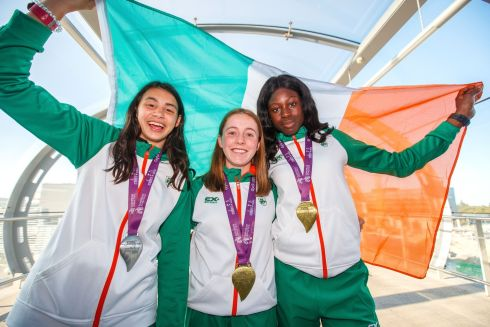 FLYING THE FLAG: Sophie O'Sullivan, Sarah Healy and Rhasidat Adeleke at Dublin Airport for the Team Ireland homecoming  after their successes the European Athletics Under-18 Championships. Photograph: Gary Carr/Inpho