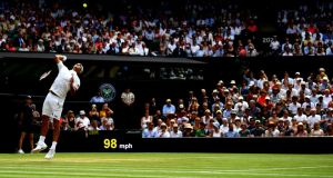 Roger Federer  serves against Adrian Mannarino  during their men's singles fourth-round match on Centre Court at Wimbledon. Photograph:  Clive Mason/Getty Images)