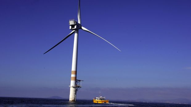 An Airtricity maintenance vessel approaches a turbine on the company's Arklow Bank windfarm. Photograph: David O'Brien.
