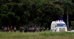 An ambulance carrying rescued schoolboys leaves a military airport in Chiang Rai, Thailand. Photograph: Tyrone Siu/Reuters