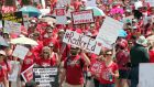 Arizona teachers march  for the #RedforEd movement in April in Phoenix, Arizona. Teachers state-wide staged a walk-out strike  in support of better wages and state funding for public schools. Photograph:  Ralph Freso/Getty Images