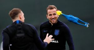 England's Harry Kane and Phil Jones play with a toy rooster during training ahead of their  World Cup semi-final  against Croatia. Photograph: Adrian Dennis/Getty Images