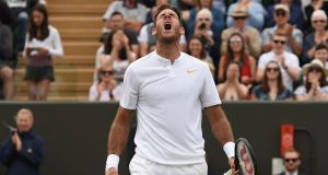 Argentina's Juan Martin del Potro celebrates after beating France's Gilles Simon 7-6, 7-6, 5-7, 7-6 during their men's singles fourth round clash at Wimbledon. Photo: Oli Scarff/Getty Images