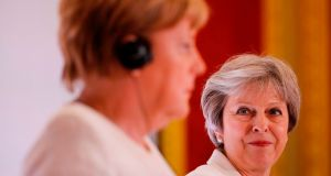 German chancellor Angela Merkel and UK prime minister Theresa May in London. Photograph: Tolga Akmen/AFP/Getty Images