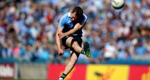 Dublin's Dean Rock  kicking a free against Laois in the Leinster  Final. The challenge for Dublin is to keep tuned up, that's the hardest job when you're on top of the playing tree.  Photograph:  Bryan Keane/Inpho