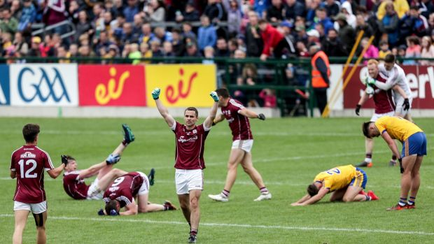 Galway players celebrate at the final whistle after beating Roscommon. Photo: Laszlo Geczo/Inpho