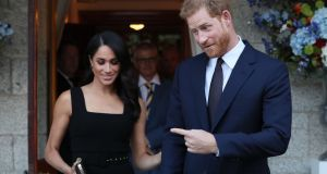Prince Harry and Meghan Markle at the British ambassador's residence at Glencairn House in Dublin. Photograph: Brian Lawless/AFP/Getty Images