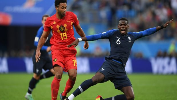 Mousa Dembele fouls Paul Pogba during his side's World Cup semi-final defeat. Photograph: Laurence Griffiths/Getty