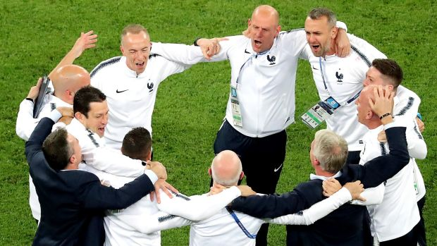 Didie Deschamps and his France coaching staff celebrate after France's 1-0 win over Belgium. Photograph: Zurab Kurtsikidze/EPA