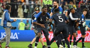 Paul Pogba and Adil Rami celebrate with France's goalscorer Samuel Umtiti. Photograph: Getty Images