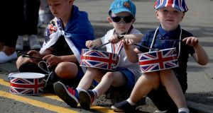 Young spectators  watch members of the Orange Order take part in the annual County Grand Orange Order Boyne Parade through Glasgow city centre on Saturday. Photograph: Jane Barlow/PA