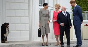 Meghan Markle (L-R) talking with Sabina Coyne as President Michael D Higgins chats to Prince Harry during the royal couple's visit at Aras an Uachtarain on Wednesday. Photograph: Clodagh Kilcoyne/WPA Pool/Getty Images