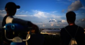 Visitors on Vorobyovy Hills enjoy the view of the Luzhniki Stadium in Moscow ahead of the  World Cup semi-final  between England and Croatia. Photograph: Matthias Hangst/Getty Images