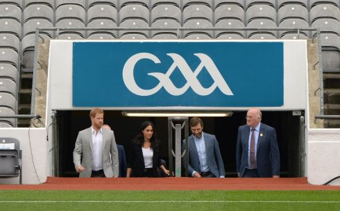 CROKE PARK: Harry and Meghan come on to the pitch with Colin Regan and  GAA president John Horan.  Photograph: Dara Mac Donaill / The Irish Times