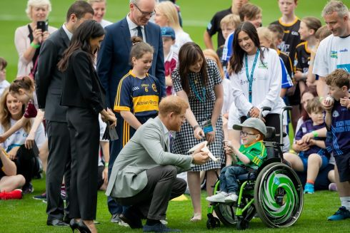 CROKE PARK: Harry and Meghan with 7-year-old Nathan Chaney Kiely. Photograph: Morgan Treacy/Inpho
