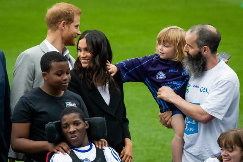 CROKE PARK: Meghan has her hair tossed by a young admirer. Photograph: Morgan Treacy/Inpho