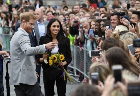 TRINITY COLLEGE: Harry and Meghan talk to well-wishers in Trinity College.  Photograph: Charles McQuillan/Getty