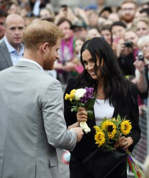 TRINITY COLLEGE: Harry and Meghan visit Trinity College after receiving flowers.  Photograph: Charles McQuillan/Getty