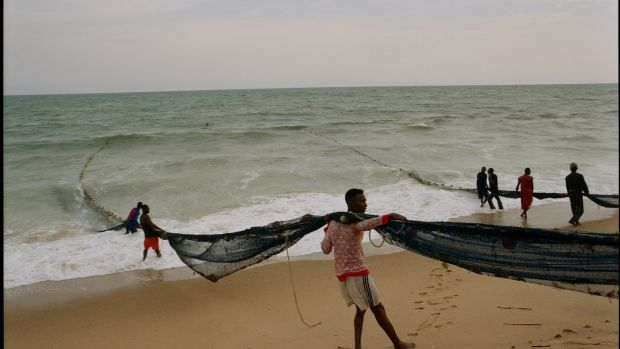 Fishermen hauling in their nets – on the beach near the village of Keta