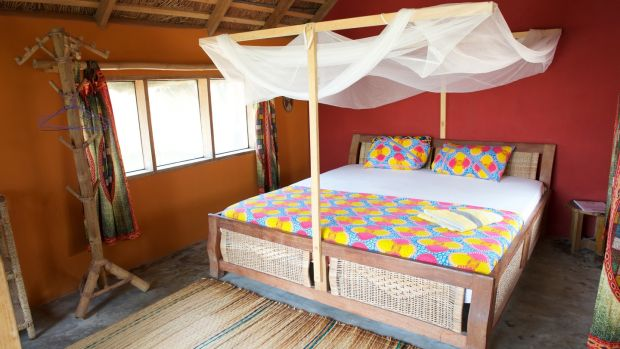 A bedroom at Meet Me There in Keta, Ghana