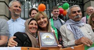 Palestinian farmer Muna al-Taneeb, from the West Bank, with Senator Frances Black outside Leinster House on Wednesday. Photograph: Crispin Rodwell/AP Images for Avaaz
