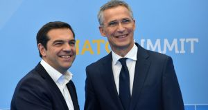 Greek prime minister Alexis Tsipras shakes hands with Nato secretary general Jens Stoltenberg during the Nato summit in Brussels. Photograph: Denis Charlet/AFP/Getty Images
