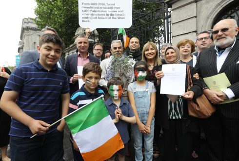 Politicians and supporters gather outside the Dail in support of the Occupied Territories Bill 2018, which was piloted by Senator Francis Black. Photograph: Lorraine O'Sullivan