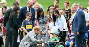 Nathan Charney-Kiely presents  Prince Harry and wife Meghan, Duke and Duchess of Sussex with a hurley as they visit Croke Park. Photograph: Getty Images