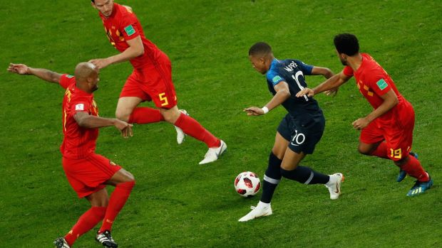 France's forward Kylian Mbappé takes on all comers during France's World Cup semi-final victory over Belgium in Saint Petersburg on Tuesday. Photograph: Adrian Dennis/AFP/Getty Images