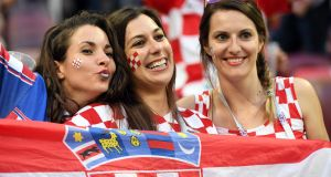 Croatia fans ahead of the World Cup semi-final football match against England at the Luzhniki Stadium in Moscow. Photograph: Yuri Cortez/AFP/Getty Images