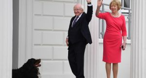 President Michael D Higgins and Sabina Higgins wave after they greeted the Duke and Duchess of Sussex after they arrived at Aras an Uactharain on Wednesday. Photograph: Joe Giddens/PA