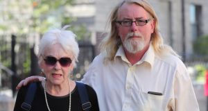 Tressa  Reeves and her son, Patrick  Farrell, leave the High Court in Dublin. Photograph:  Niall Carson/PA Wire