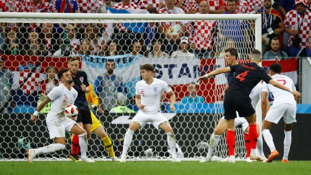 England's Kyle Walker's concentration may have been affected by blocking Ivan Perisic's shot. Photograph: Kai Pfaffenbach/Reuters