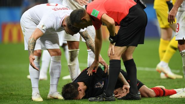 Referee Cuneyt Cakir checks on Mario Mandzukic of Croatia after he goes down after colliding with Jordan Pickford's studs. Photograph: Matthias Hangst/Getty Images