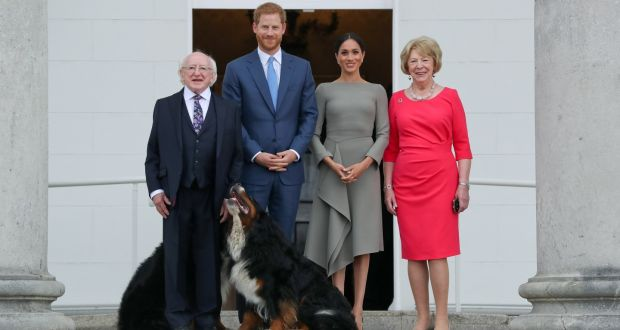 Prince Harry and  Meghan Markle with  President Michael Higgins  and his wife, Sabina, with  Bród and Siodá, Michael D's Bernese Mountain dogs. Photograph: Getty Images