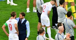 England manager Gareth Southgate hugs England skipper Harry Kane after the World Cup semi-final defeat to Croatia in Moscow. Photograph: Mladen Antonov/AFP/Getty Images
